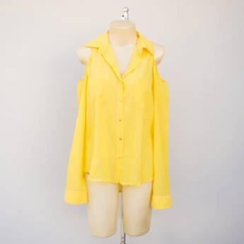 Comprar o produto de Camisa amarela ombro taxas Tricomix em Roupas e Acessórios pela empresa Loja Ego - Moda Feminina Multimarcas em Botucatu, SP por Solutudo